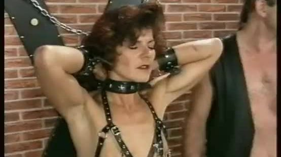 Milf slave with metal clamps on her nipples and her pussy lips gets hot candle wax